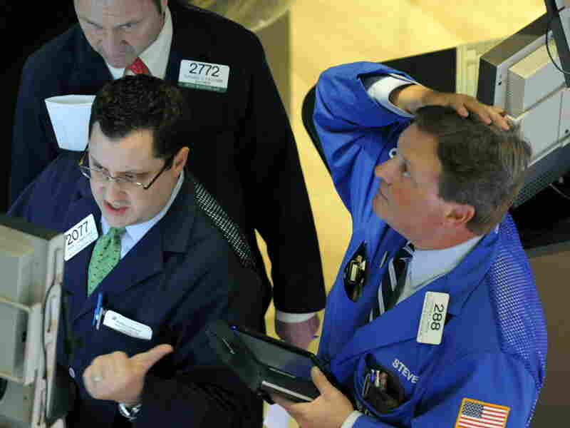 """A trader on the floor of the New York Stock Exchange looks at stocks during the final minutes of trading on May 6. The Dow fell more than 600 points in a few minutes in what became known as the """"flash crash."""""""