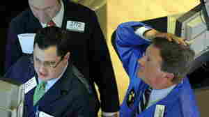 "A trader on the floor of the New York Stock Exchange looks at stocks during the final minutes of trading on May 6. The Dow fell more than 600 points in a few minutes in what became known as the ""flash crash."""