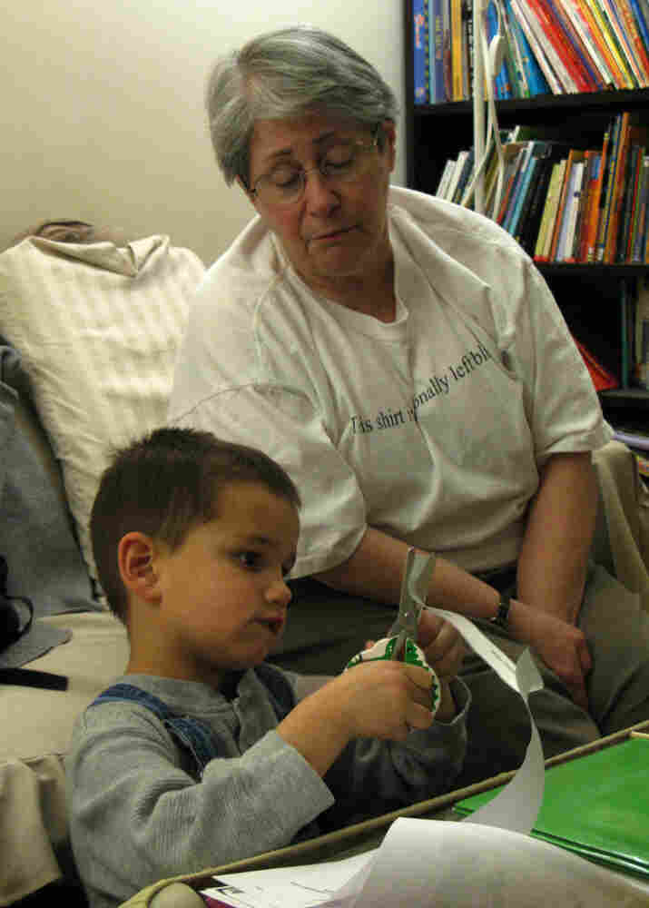 Stephanie Zirkin helps her grandson, Stephen, with his homework.