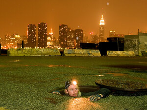 Steve Duncan emerges from a manhole in New York City.