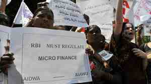 Activists of The All-India Democratic Women's Association protest Dec. 14 in front of the Reserve Bank of India, India's central banker, against microfinance institutions.