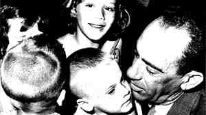George Guarch greets children at the Miami airport in the early 1960s. His daughter, Lynn, says George would sometimes carry very young children off the planes from Cuba.