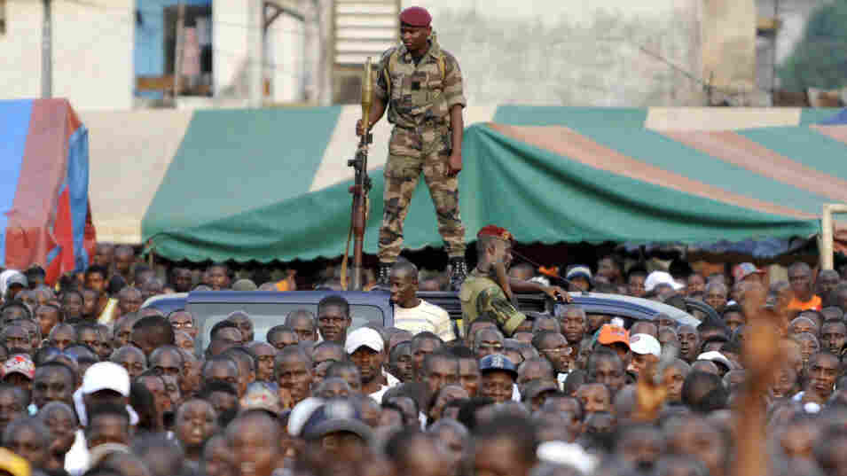An Ivory Coast soldier stands guard during a rally held by Charles Ble Goude (unseen), leader of Ivory Coast's Young Patriots, in Abidjan on Wednesday. Defiant Ivory Coast leader Laurent Gbagbo's most notorious lieutenant on Wednesday urged the strongman's diehard supporters to launch an unarmed assault on rival Alassane Ouattara's UN-defended base.