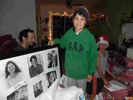 Caetano shows off his just unwrapped framed collection of autographed pictures from NPR hosts.