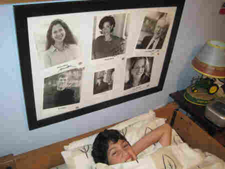 The autographed glossies hang above the bed, near the clock radio that Caetano has tuned to NPR.