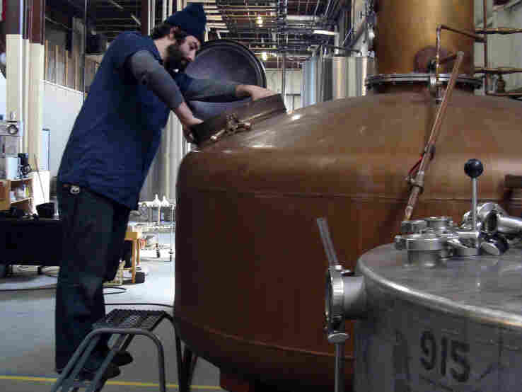 Jason Lippa fires up the still at Stranahan's distillery. The whiskey-maker is one of Colorado's most established craft distilleries.