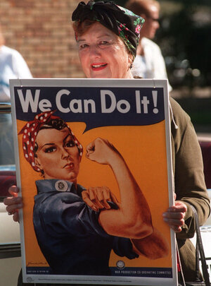 Geraldine Hoff Doyle, in 1997, with a copy of the famous poster her image helped inspire.