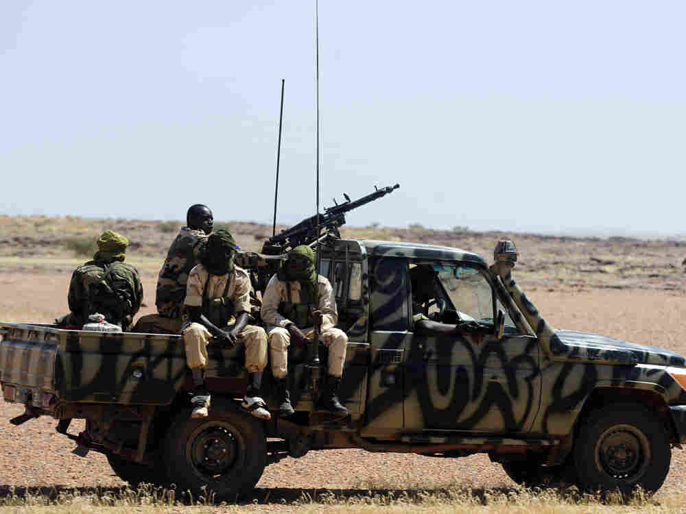 Soldiers from Niger patrol the road between Agadez and Arlit in September.