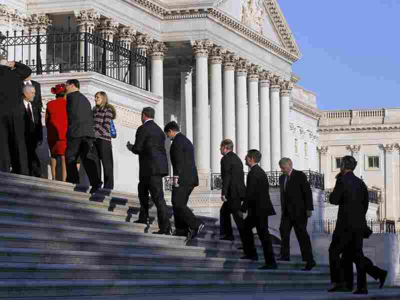 Members of the House's incoming freshmen class walk up the steps of the Capitol to pose for a group photo on Nov. 19.