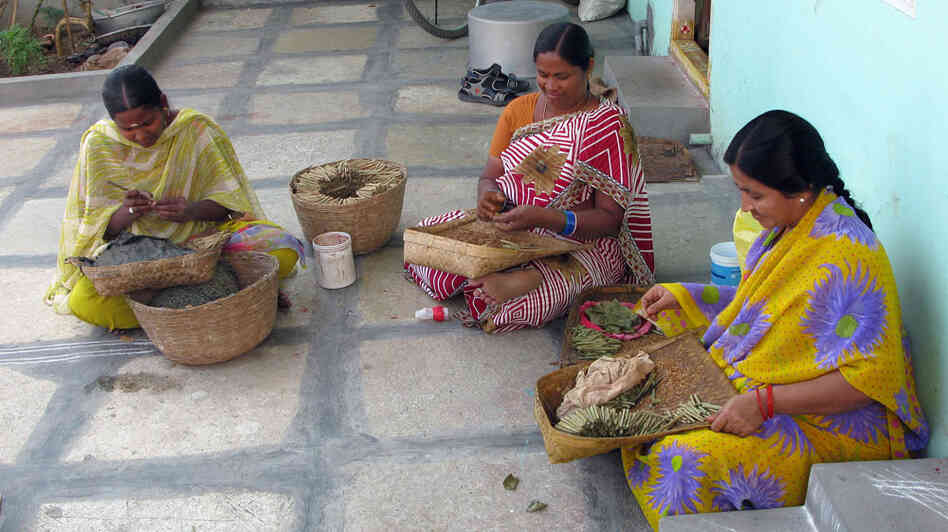 Rama (right) rolls small cigars called bidis, for a living, making between 30  and 40 rupees a day, less than a dollar.  She says she owes more than $1,200 in  loans to five microfinance companies -- money she can never hope to repay.