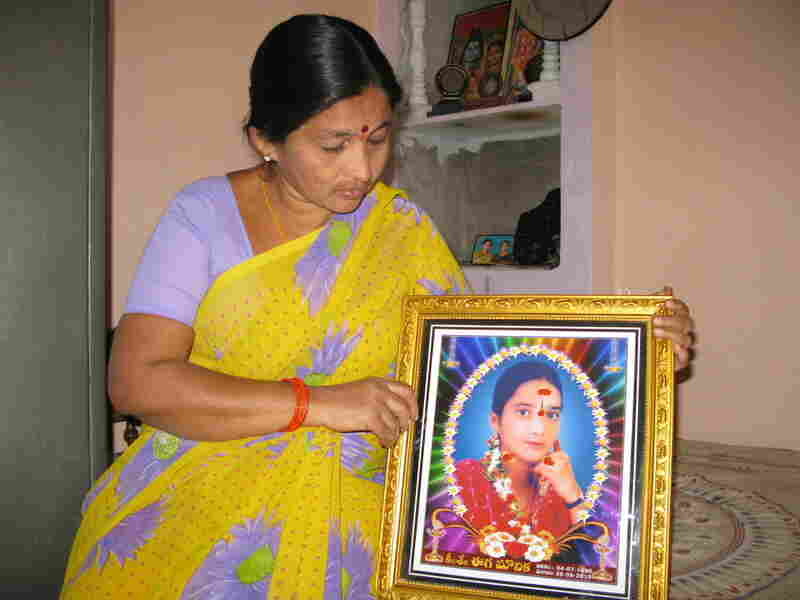 Rama holds a photo of her daughter Mounika, who burned herself to death at the  age of 17.  Rama says her daughter was driven to despair by microloan debt  collectors who harassed the family for payment.