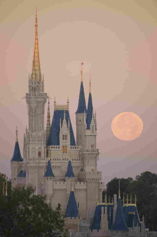 A full moon over Cinderella Castle at Disney World on December 21, 2010 in Lake Buena Vista, Florida.