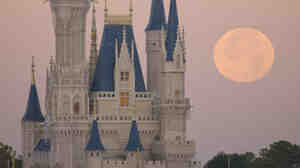 A full moon over Cinderella Castle at Disney World on December 21, 2010 in Lake Buena Vista, Florida.