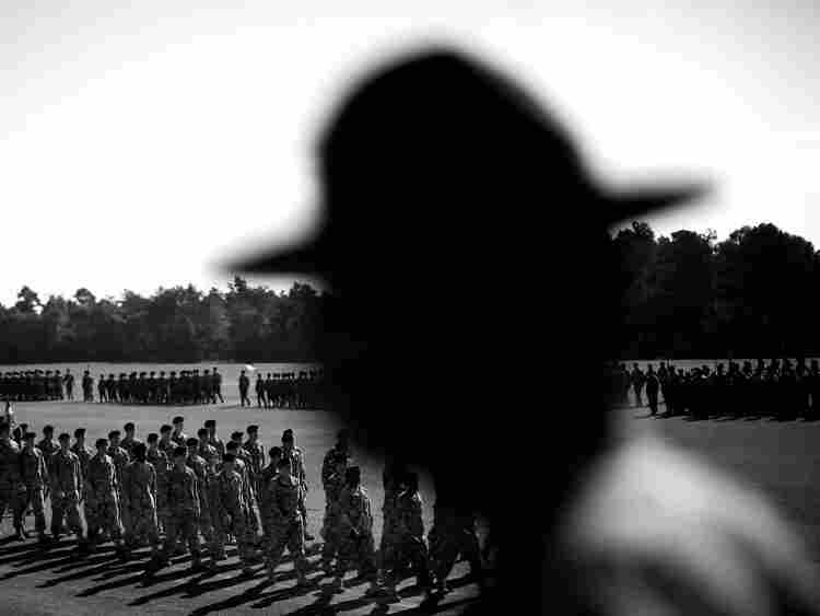 "A drill seargent watches the graduation ceremony for the completion of basic training at Fort Jackson. A new report by the non-profit research organization ""The Education Trust"" shows that very few high school graduates have the basic math, reading or problem-solving skills necessary to enlist in the army and other branches of the military."