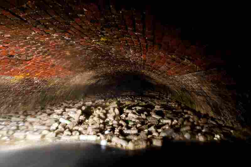 Trash and congested sewage blocks the way in the Canal Street Sewer in Manhattan. This became New York City's first underground sewer when it was roofed over around 1812; prior to that it had been an open ditch, the eponymous Canal of Canal Street.