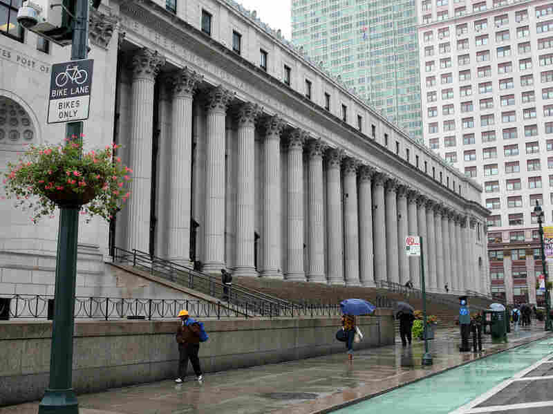 You can still mail a letter at the Farley Post Office, but most of the huge structure is deserted.
