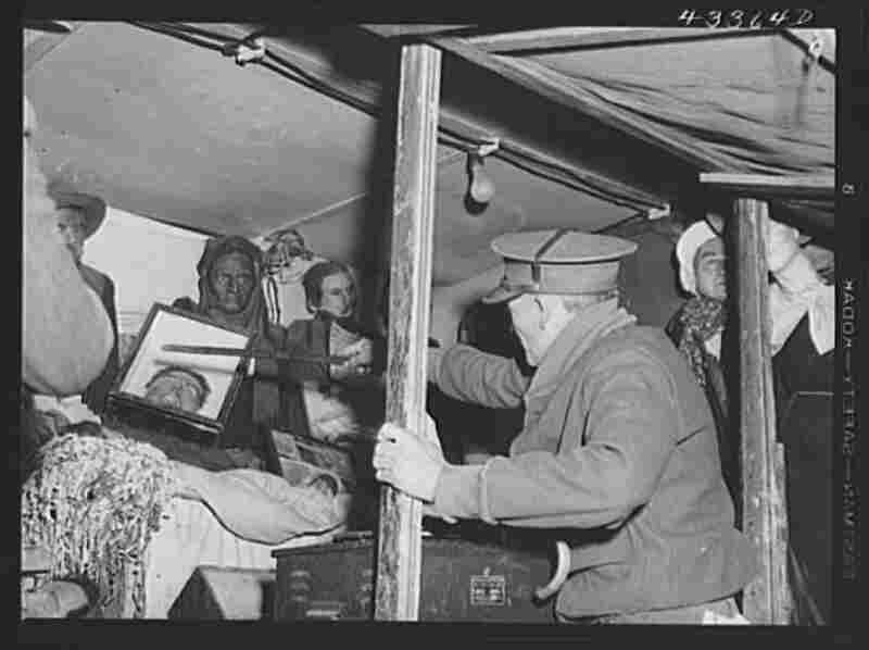 Inside the traveling sideshow, Thornton points out the exhibits.