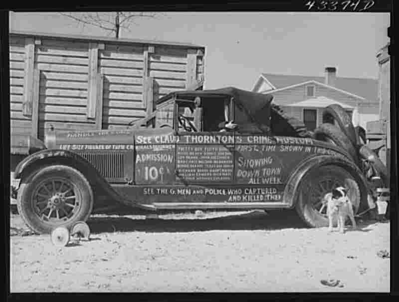 A car advertises the travelling sideshow.
