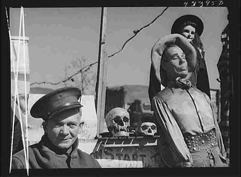 """Veteran Claud Thornton, owner of the traveling """"crime museum"""" stands with a few of his effigies near Fort Bragg, N.C."""