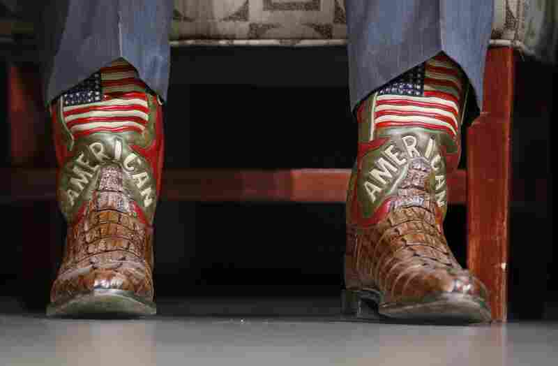 Schwarzenegger, well known for his macho swagger, shows off his American flag boots while speaking at the Commonwealth Club in Santa Clara.