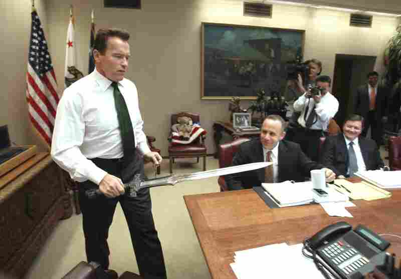 Schwarzenegger performed his job with Hollywood flair — such as when he brought the sword he used in the movie Conan the Barbarian to the conference table before the start of budget negotiations with legislative leaders in January 2009.