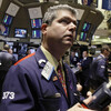 Trader John Panin checks prices on the floor of the New York Stock Exchange.