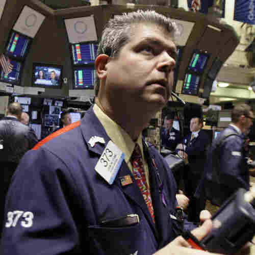 Trader John Panin checks prices on the floor of the New York Stock Exchange.