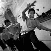Students participate in a team-building activity. These 13- and 14-year-olds are  vulnerable to gangs and have already been exposed to violence. Fifteen students who  attend Chicago Public Schools have died by gunfire this school year.