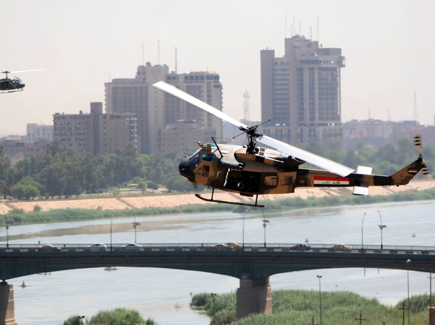 Iraqi army helicopters fly over Baghdad in September. Analysts say Iraq's air defense is one area in which the country still needs help from the U.S. military.
