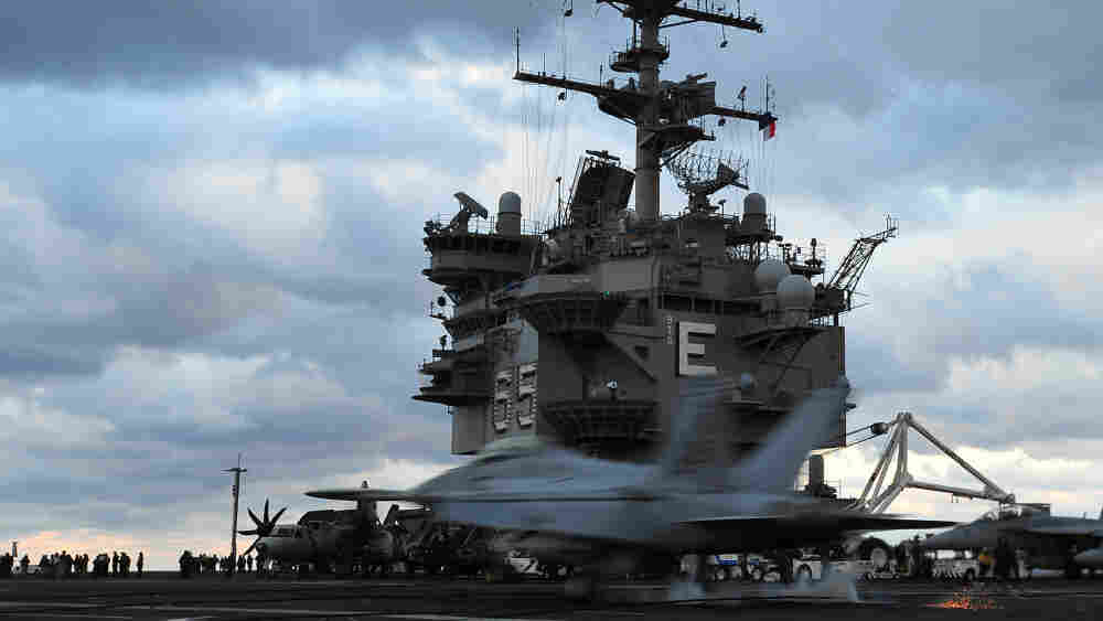 An F/A-18F Super Hornet lands aboard the aircraft carrier USS Enterprise (CVN 65). The ship's commander is currently under investigation for raunchy videos he made when he was her executive officer.