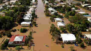 Rising floodwaters spread through the low-lying suburb of Depot Hill in Rockhampton, in eastern Queensland.