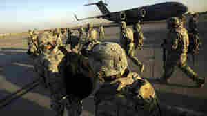 Iraq's leadership is signaling that it wants the U.S. military out of the country by the end of 2011. Here, members of the U.S. 1st Brigade, 3rd Infantry Division, walk toward a C-17 aircraft in Baghdad before returning home to Fort Stewart, Ga., in November.