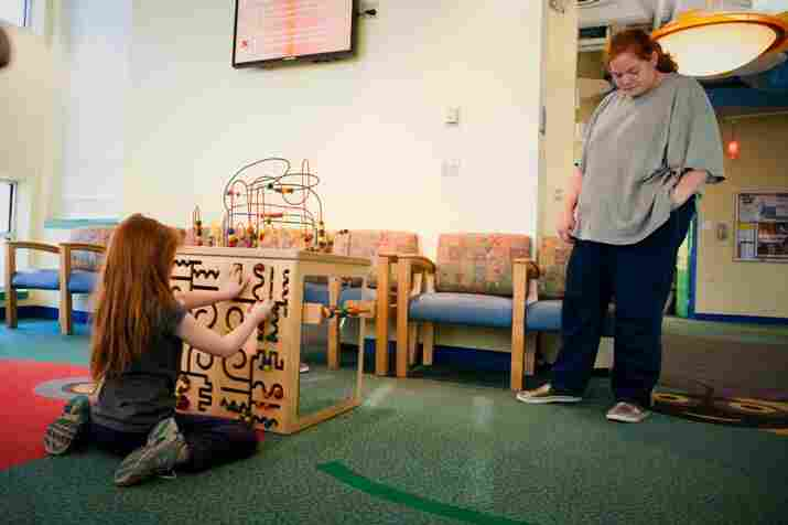 Katie and her mother, Sherri Oliver, travel two hours by bus from the Eastern Shore of Maryland every month to come to the lead clinic at the Mt. Washington Pediatric Hospital.