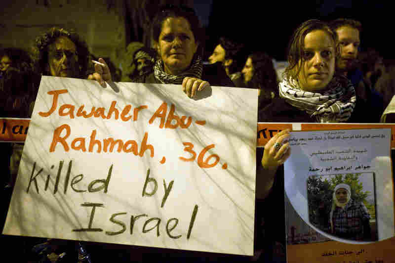 Nearly 200 people demonstrate in Tel Aviv on Saturday. Jawaher Abu Rahmah, a 36-year-old Palestinian woman, died overnight after being tear gassed by Israeli troops at a West  Bank protest.