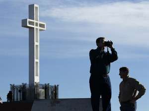 Rev. John Fredericksen of Orlando, Fla., takes a picture in front of the war memorial cross in a San Diego public park on Tuesday.