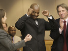 Cornelius Dupree Jr., center, raises his hands in celebration with his lawyer Nina Morrison, left, and attorney Barry Scheck in Dallas on Tuesday, Jan. 4, 2010.