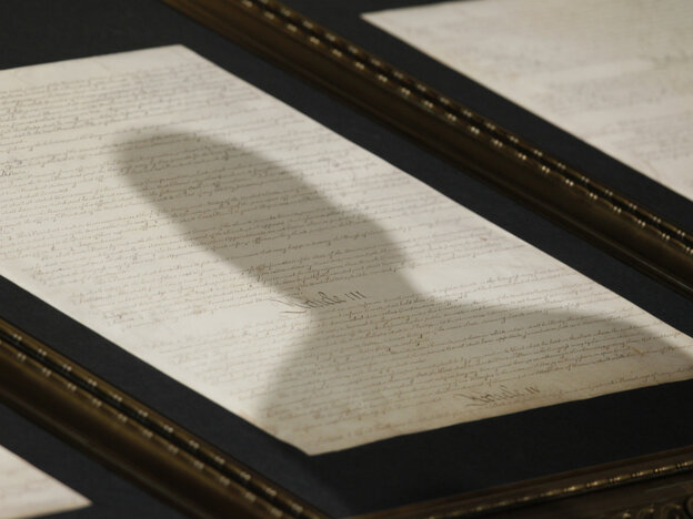 President Obama's shadow is cast on the Constitution as he delivers an speech at the National Archives in Washington
