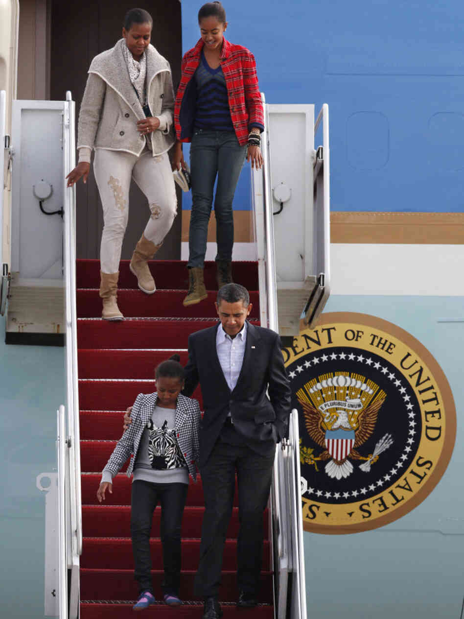 President Barack Obama, with daughter Sasha, 9, and first lady Michelle Obama, with daughter Sasha, 9, exit Air Force One after returning from vacation in Hawaii, Tuesday, Jan. 4, 2011, at Andrews Air Force Base, Md. (AP Photo/Jacquelyn Martin)