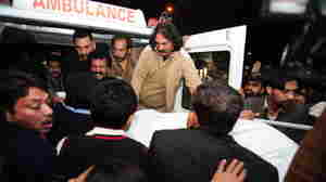 The body of Punjab Gov. Salman Taseer is loaded into an ambulance in Islamabad earlier today.