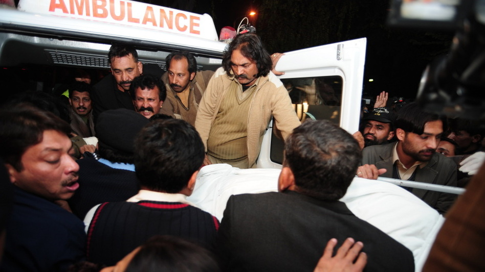 The body of Punjab Gov. Salman Taseer is loaded into an ambulance in Islamabad earlier today. (AFP/Getty Images)