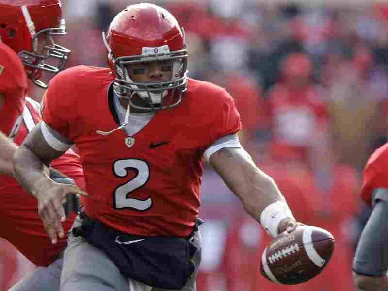 """Ohio State'sTerrellePryorplays against Michigan during an NCAA college football game. Pryor and four of his teammates have been suspended for the first five games of the 2011 season for """"accepting improper benefits."""""""