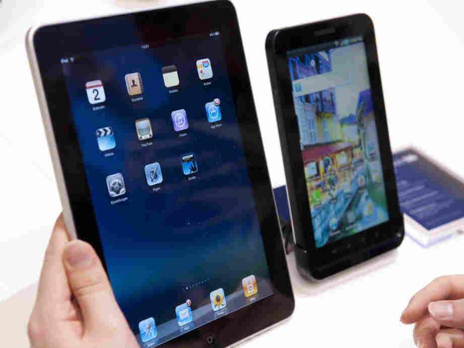 The CES is expected to feature more tablets to compete with the Apple iPad, left, and Samsung Galaxy Tab, right.