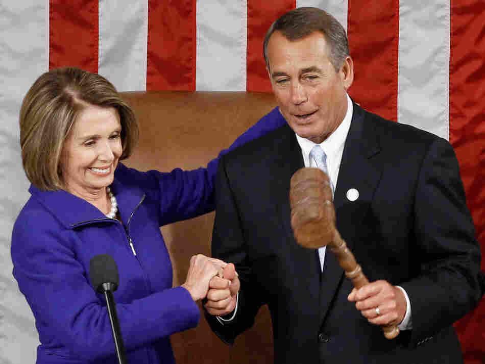 Newly minted Speaker of the House John Boehner (R-OH) receives the speaker's gavel from outgoing speaker Nancy Pelosi (D-CA).