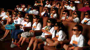 Children from Los Angeles-area Boys and Girls Club summer camps reenact the iconic '50s LIFE magazine photo of movie goers wearing 3-D glasses.