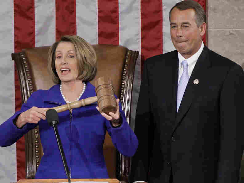 Outgoing Speaker Nancy Pelosi prepares to hand the gavel to Speaker-elect John Boehner as the 112th Congress opens.