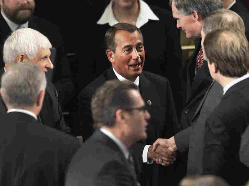House Speaker John Boehner of Ohio greets House members during the first session of the 112th Congress on Wednesday.