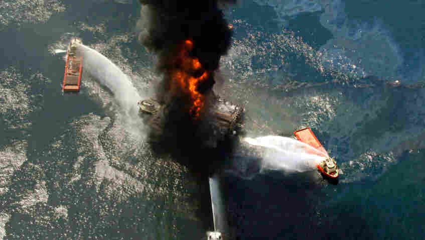 The Deepwater Horizon oil rig burns in the Gulf of Mexico last April. An excerpt of a presidential commission's probe  into the rig explosion released on Thursday says risky decisions caused the disaster.