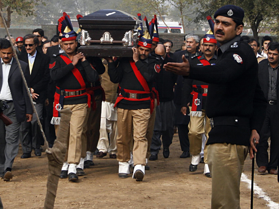 In Lahore, Pakistani police guards carry the coffin of late Punjab governor Salman Taseer ; Jan. 5, 2011.