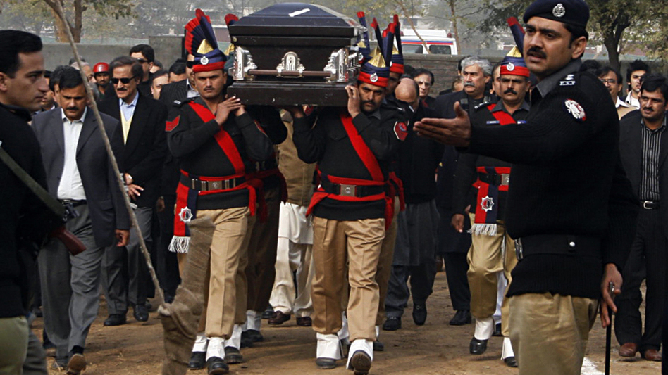 In Lahore, Pakistani police guards carry the coffin of late Punjab governor Salman Taseer ; Jan. 5, 2011. (AFP/Getty Images)