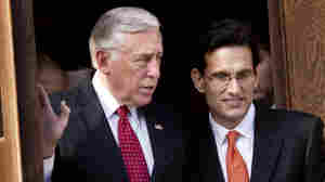 Democrat Steny Hoyer of Maryland (left), who will be the House minority whip in the new Congres, and Republican Eric Cantor of Virginia, the incoming majority leader, leave after a prayer service Wednesday at St. Peter's Catholic Church in Washington, D.C.